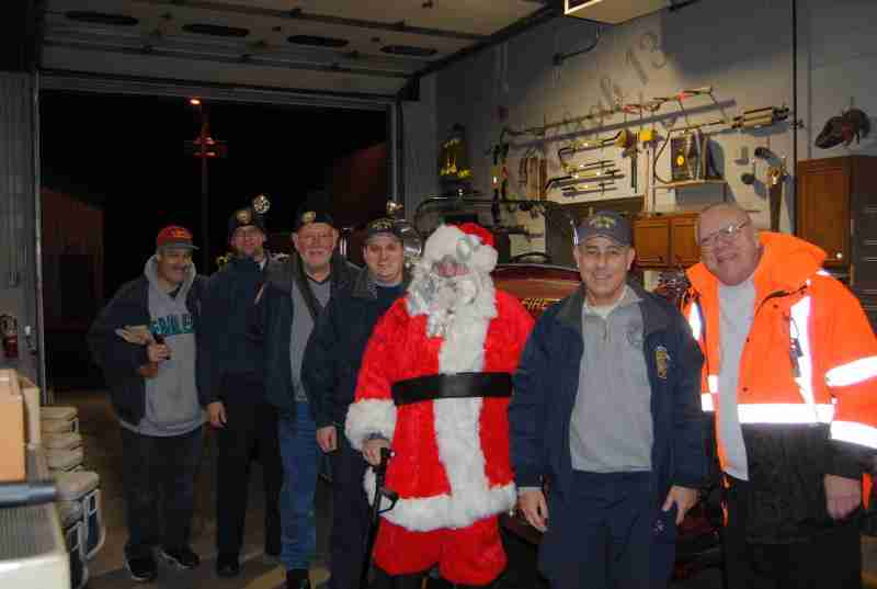 SANTA CLAUS ARRIVES IN THE OLD ORCHARD SECTION LAST NIGHT FOR A VISIT
